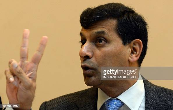 Reserve Bank of India governor Raghuram Rajan gestures during a press conference in Mumbai on November 13 2013 Seeking to calm currency markets Rajan...