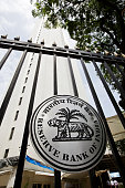 Reserve Bank of India signage hangs outside the central bank's headquarters in Mumbai India on Monday July 22 2013 The RBI said importers will have...