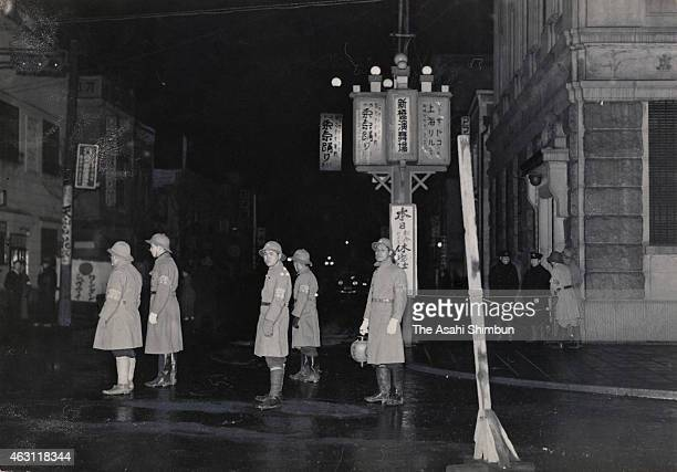 Reserve duty soldiers voluntarily patrol a street during the February 26 Incident on February 26 1936 in Tokyo Japan