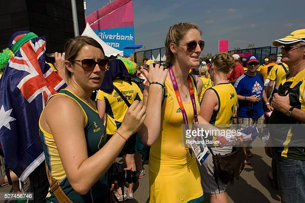 Reserve goalkeeper Ashlee Wells and fellowmembers of the Australian Women's Hockey team emerge after their 20 victory over China to secure an overall...