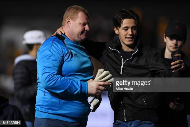 Reserve goalkeeper Wayne Shaw poses for a selfie with a fan after The Emirates FA Cup Fifth Round match between Sutton United and Arsenal at Gander...