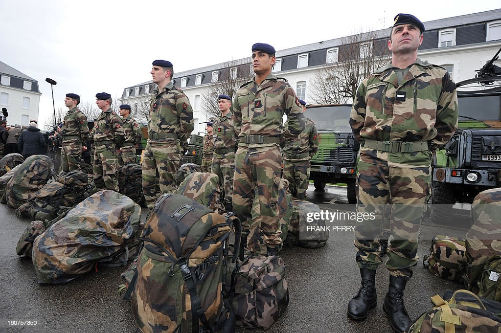 Reserve 'Guepard' soldiers from the third RIMA (Marine Infantry Regiment) present themselves during a visit by French defence minister Jean-Yves Le Drian (unseen) on February 5, 2013 in Vannes. After a three-week campaign by French-led forces drove Islamist extremists from most of their strongholds in northern Mali, including the cities of Timbuktu and Gao, dozens of French warplanes carried out major air strikes on rebel training and logistics centres on February 3 in Mali's mountainous northeast, near the Algerian border. France is eager to pass the baton in Mali to some 8,000 African troops pledged for the UN-backed AFISMA force, still deploying at a snail's pace, after sweeping to its former colony's aid on January 11 as the Islamists threatened to advance south towards the capital Bamako. AFP PHOTO/FRANK PERRY