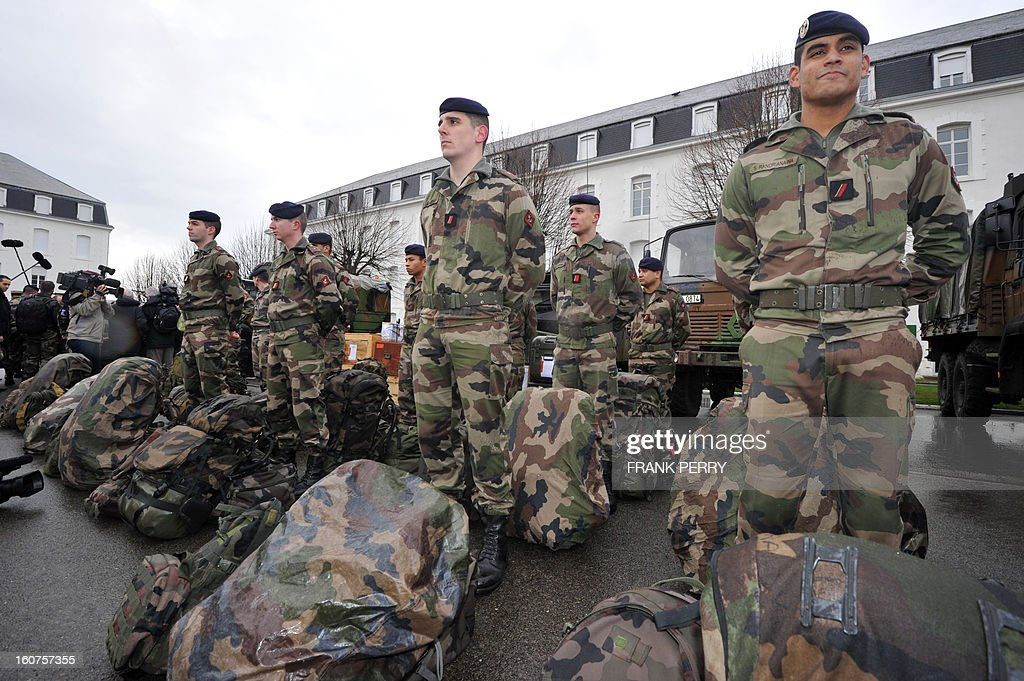 Reserve 'Guepard' soldiers from the third RIMA (Marine Infantry Regiment) present themselves during a visit by French defence minister Jean-Yves Le Drian (unseen) on February 5, 2013 in Vannes. After a three-week campaign by French-led forces drove Islamist extremists from most of their strongholds in northern Mali, including the cities of Timbuktu and Gao, dozens of French warplanes carried out major air strikes on rebel training and logistics centres on February 3 in Mali's mountainous northeast, near the Algerian border. France is eager to pass the baton in Mali to some 8,000 African troops pledged for the UN-backed AFISMA force, still deploying at a snail's pace, after sweeping to its former colony's aid on January 11 as the Islamists threatened to advance south towards the capital Bamako.