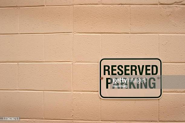 Reserved Parking Sign On Wall