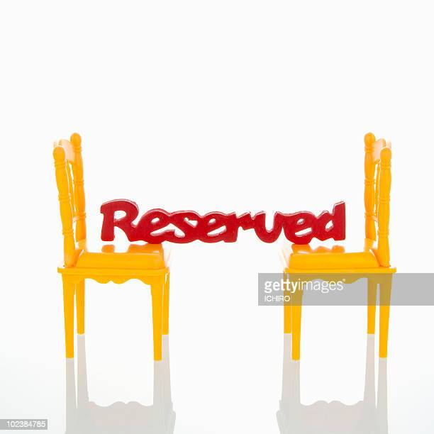 'Reserved' sign on the chairs.