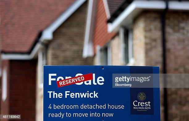 A 'Reserved' sign stands outside a newly constructed four bedroom home at a Crest Nicholson Holdings Plc residential housing development site in East...