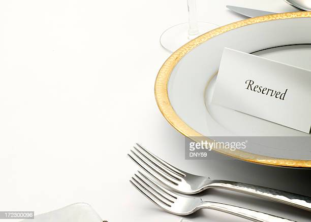 Reserved table tent on top of table setting