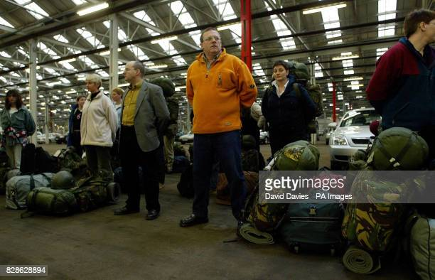 Reservists wait to be processed on arrival at the Reserves Training and Mobilisation Centre at Chetwynd Barracks Chilwell in Nottingham * All...
