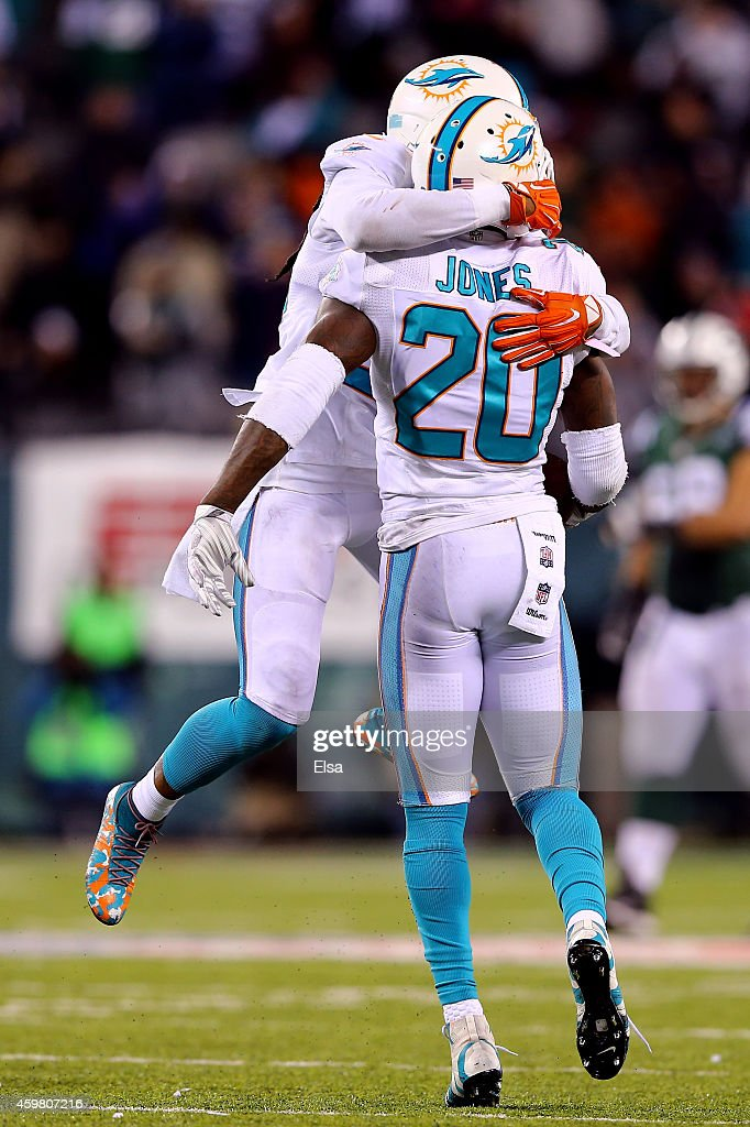 <a gi-track='captionPersonalityLinkClicked' href=/galleries/search?phrase=Reshad+Jones&family=editorial&specificpeople=4511449 ng-click='$event.stopPropagation()'>Reshad Jones</a> #20 of the Miami Dolphins celebrates with <a gi-track='captionPersonalityLinkClicked' href=/galleries/search?phrase=Louis+Delmas&family=editorial&specificpeople=5680392 ng-click='$event.stopPropagation()'>Louis Delmas</a> #25 after intercepting a ball intended for <a gi-track='captionPersonalityLinkClicked' href=/galleries/search?phrase=Jeff+Cumberland&family=editorial&specificpeople=3954306 ng-click='$event.stopPropagation()'>Jeff Cumberland</a> #85 of the New York Jets late in the fourth quarter during their game at MetLife Stadium on December 1, 2014 in East Rutherford, New Jersey.