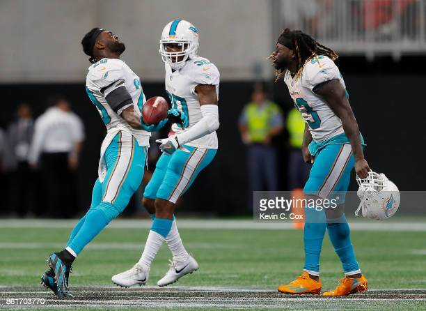 Reshad Jones of the Miami Dolphins reacts after intercepting a pass intended for Austin Hooper of the Atlanta Falcons in the final seconds with...