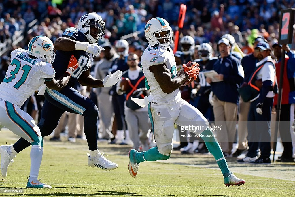 <a gi-track='captionPersonalityLinkClicked' href=/galleries/search?phrase=Reshad+Jones&family=editorial&specificpeople=4511449 ng-click='$event.stopPropagation()'>Reshad Jones</a> #20 of the Miami Dolphins runs back an interception for a touchdown against of the Tennessee Titans during the second half of a game at Nissan Stadium on October 18, 2015 in Nashville, Tennessee.