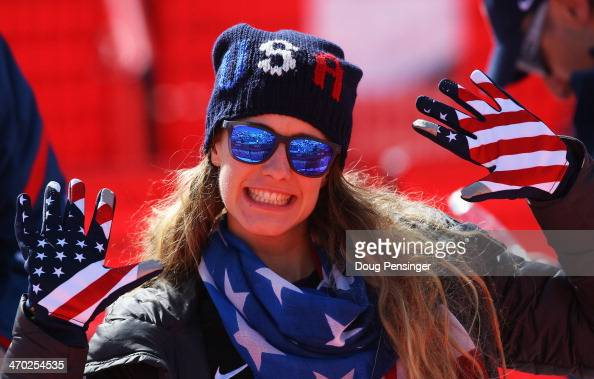 Resi Stiegler of the United States enjoys the atmosphere during the Alpine Skiing Men's Giant Slalom on day 12 of the Sochi 2014 Winter Olympics at...