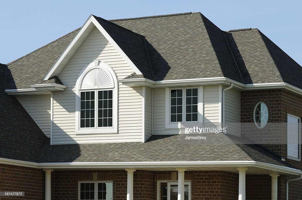 Residence Home With Vinyl Siding Brick Gabled