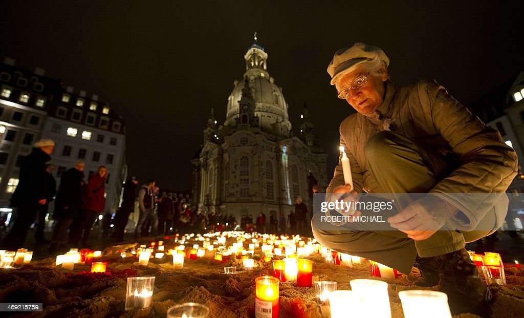 Resident Annemarie Kowal lights candles to commemorate the 69nd anniversary of the bombing of Dresden on February 13, 2014 in front of the Frauenkirche (Church of Our Lady) in Dresden, eastern Germany, against right-wing extremism as residents of Dresden commemorate the 69nd anniversary of the bombing of Dresden. A massive bombing raid by Allied forces on Dresden beginning on February 13, 1945 sparked a firestorm that destroyed much of the historical centre of the city. AFP PHOTO / ROBERT MICHAEL