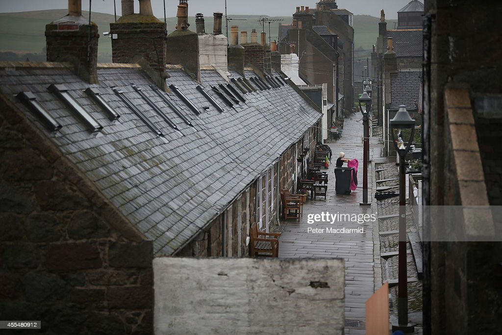 A resident cleans her house in the Footdee area on September 15 2014 in AberdeenScotland The latest polls in Scotland's independence referendum put...
