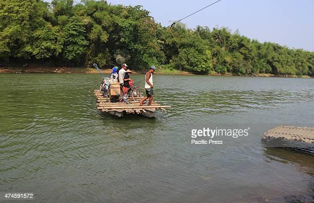 PROGO YOGYAKARTA INDONESIA resident cross the river using a chartered traditional bamboo raft on the progo river Yogyakara Province Indonesia Bamboo...