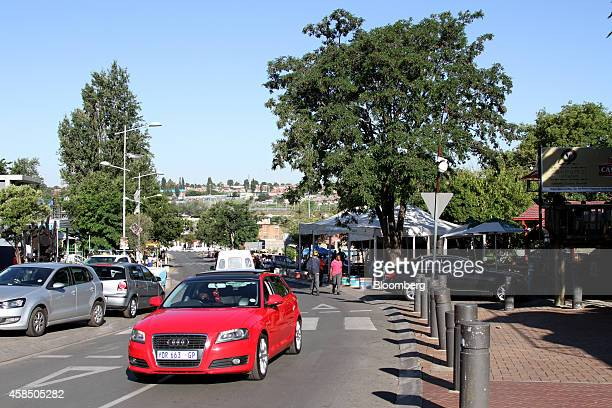 A resident drives a red Audi AG automobile along Vilakazi street in Soweto South Africa on Wednesday Nov 5 2014 Township economies have the potential...