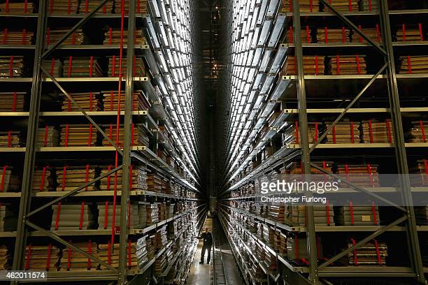 Resident engineer John Roberts poses as he looks at the millions of newspapers stored on racks at the National Newspaper Archive on January 23 2015...