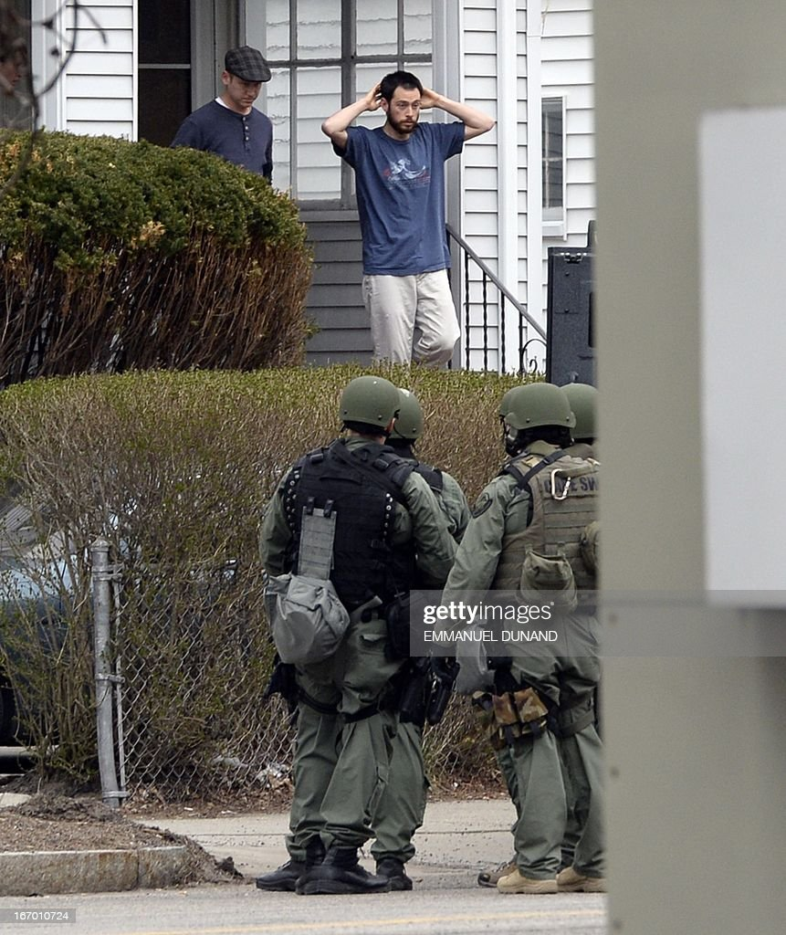 Resident exit a home as police SWAT team search houses for the second of two suspects wanted in the Boston Marathon bombings takes place April 19...