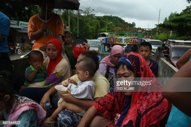 Resident fleeing from Marawi citywhere gunmen who had declared allegiance to the Islamic State group rampaged through the southern city are cramped...