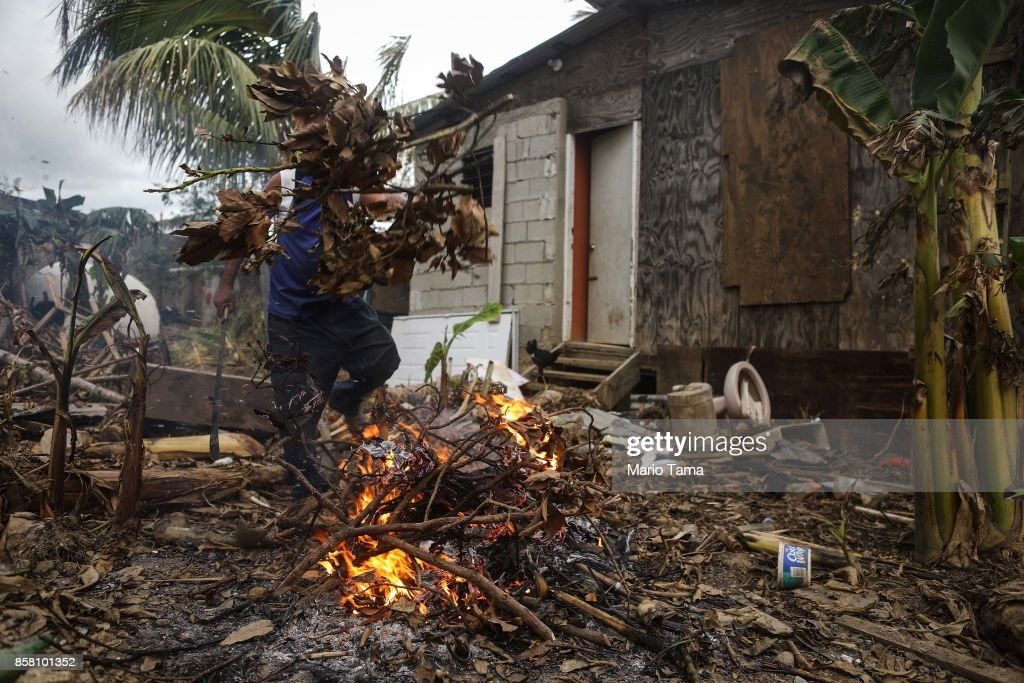 Resident Francisco Duran burns downed tree limbs on his property about two weeks after Hurricane Maria swept through the island on October 5, 2017 in San Isidro, Puerto Rico. Residents in his section of the town remain without grid power or running water. Puerto Rico experienced widespread damage including most of the electrical, gas and water grid as well as agriculture after Hurricane Maria, a category 4 hurricane, swept through.
