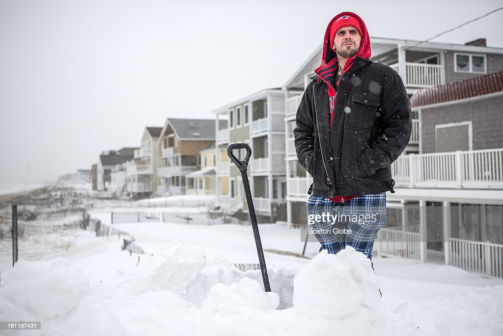 Resident Frank Baldwin surveyed the damage along the waterfront from the top of a mound of snow in Salisbury as a large winter storm hit the region.