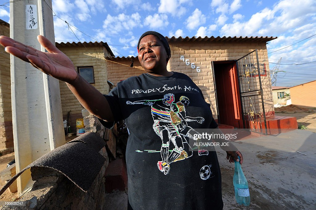 A resident in the township of Alexandra wears a t-shirt reading 'proudly South African' in Johannesburg on May 7, 2010.