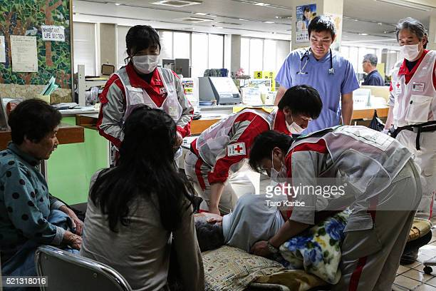 A resident is operated on by a rescue team after an earthquake hit the area on April 15 2016 in Mashiki Kumamoto Japan At least nine people have died...