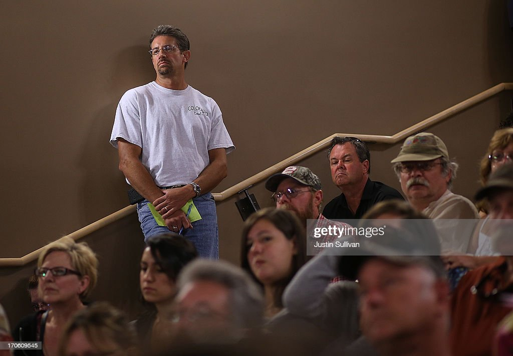 Resident look on during a community meeting to update the status of the Black Forest fire at Palmer Ridge High School on June 15, 2013 in Monument, Colorado. The Black Forest fire is the most destructive in Colorado history, having consumed more than 15,000 acres as of this morning while destroying 473 homes. Two people have died in the fire. .