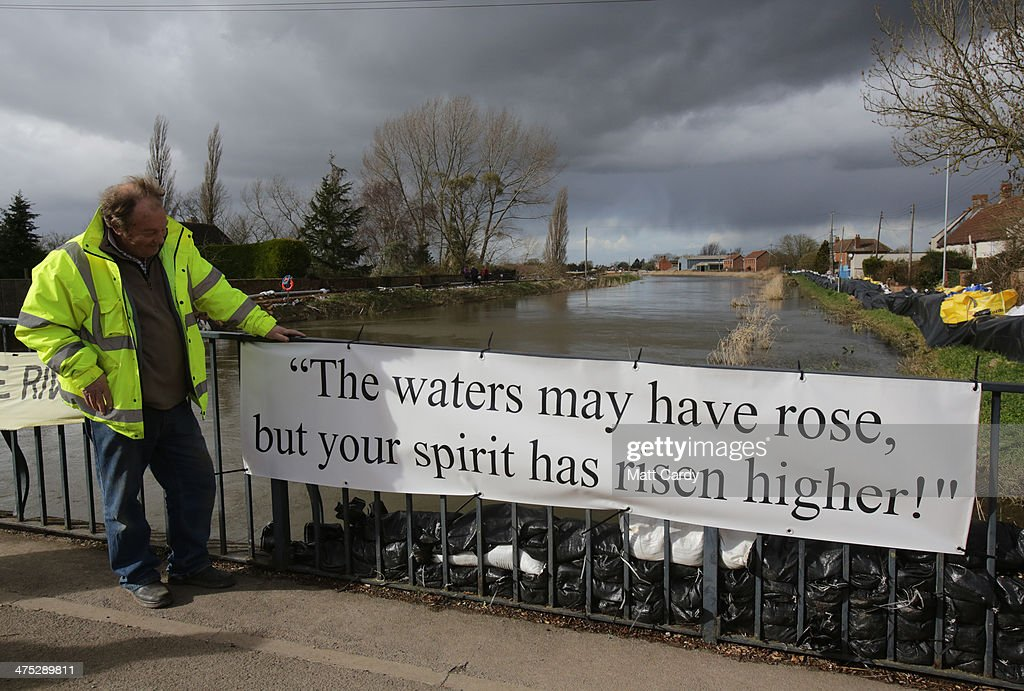 A resident looks at a banner that has been put on the bridge at Burrowbridge on the Somerset Levels on February 27, 2014 in Somerset, England. According to the Met Office, England and Wales have experienced their wettest winter since records began in 1766, with parts of flood-hit southern England having experienced 83% more rain than average.