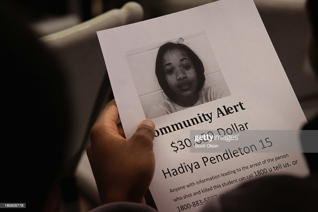 A resident looks over a reward flyer distributed at a community meeting inspired by the death of Hadiya Pendleton on February 1, 2013 in Chicago, Illinois. Pendleton, a fifteen-year-old high school honor student, was shot and killed while hanging out with friends on a rainy afternoon under a shelter in Harsh park in the Kenwood neighborhood on January 29. The reward for her killer has since been raised to $40,000. Pendleton was the 44th homicide recorded in Chicago for 2013.