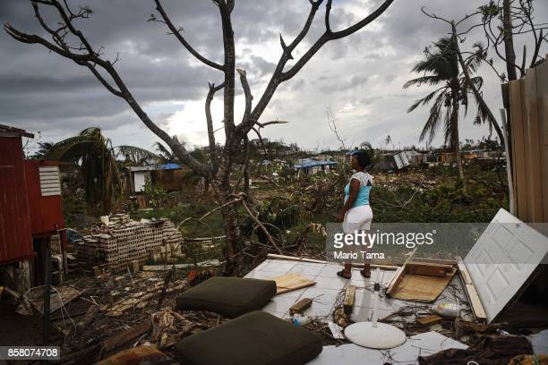 Resident Mirian Medina stands on her property about two weeks after Hurricane Maria swept through the island on October 5 2017 in San Isidro Puerto...