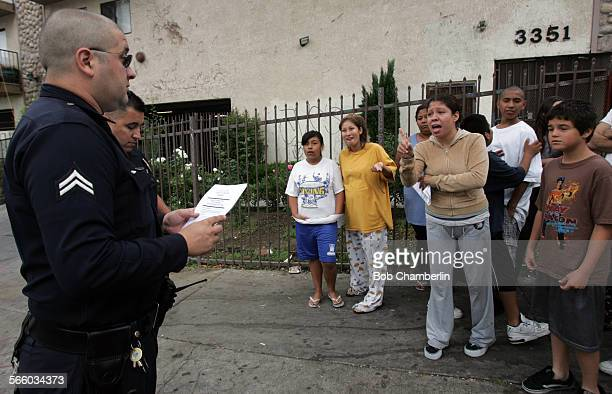 Resident of 3351 Drew Street Patricia Gomez scolds LAPD officers because her children were frightened around 4 am during a raid on her building when...