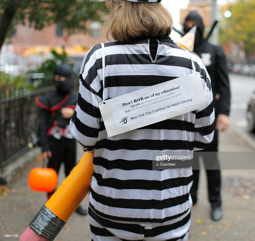 A resident of BedfordÐStuyvesant poses for a photo as she and her family 'Trick or Treats' in BedfordÐStuyvesant, Brooklyn on October 31, 2013 in New York City.