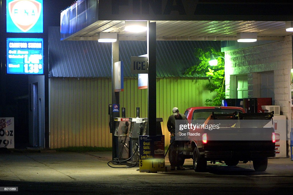 A resident of Crawford Texas fills his gas tank April 13 2001 on the way to work early in the morning Crawford the hometown of US President George W...