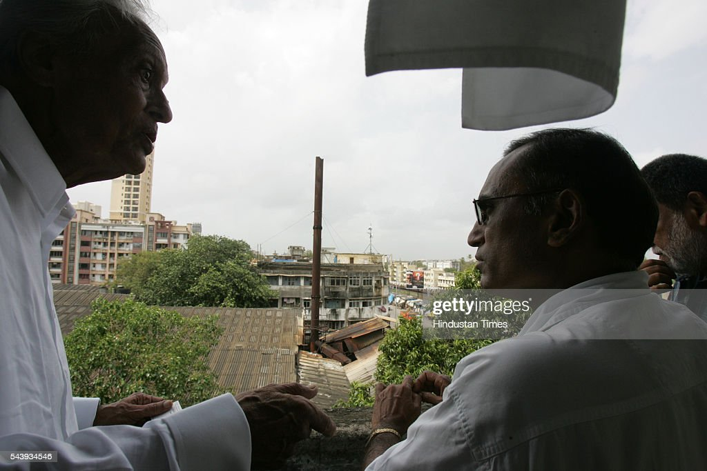 A resident of Devi Bhavan complains to B. D. Wade, pollution control officer about the pollution caused by the chimney at new era mills that broke down in 2003. Mumbai pollution control has been turning a deaf ear to the complaints made by the residents of Devi Bhavan and Mani Nivas, Matunga for the past two years. (Photo by Rajanish Kakade/Hindustan Times via Getty Images