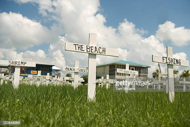 A resident of Grand Isle LA displays graves markers indicating summertime activities lost due to the Deepwater Horizon oil spill which exploded April...