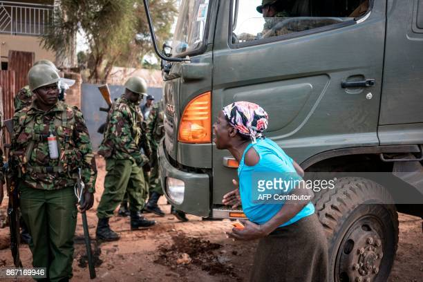 A resident of Kawangware district of Nairobi vents her anger to the police forces on October 27 2017 during post electoral violence Kenya found...
