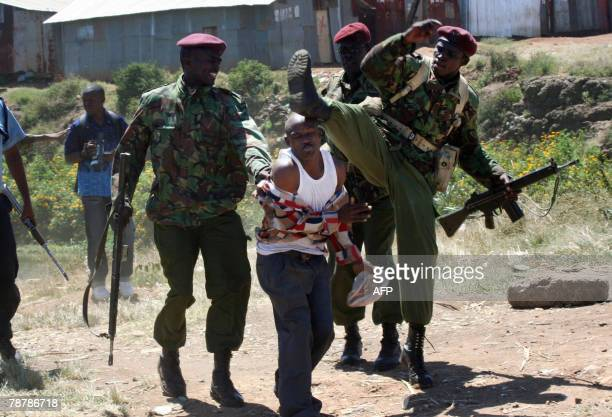 A resident of the Lakisama neighborhood in Nairobi gets kicked in the face by Kenyan police after the authorities were called in to stop fighting...
