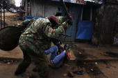 A resident of the Mathare slum of Nairobi gets beat by Kenyan police 17 January 2008 Kenyan police shot two people dead in a Nairobi slum Thursday an...