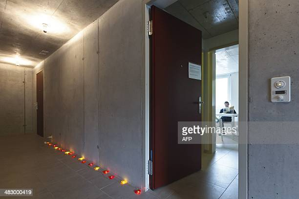 A resident of the newly opened apartment building of Swiss Healthy Life and Living Foundation for Multiple Chemical Sensitivity sits in one of the...