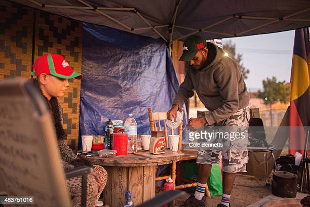 A resident of the tent embassy prepares to make a cup of tea at the tent embassy on August 9 2015 in Sydney Australia The tent embassy was...
