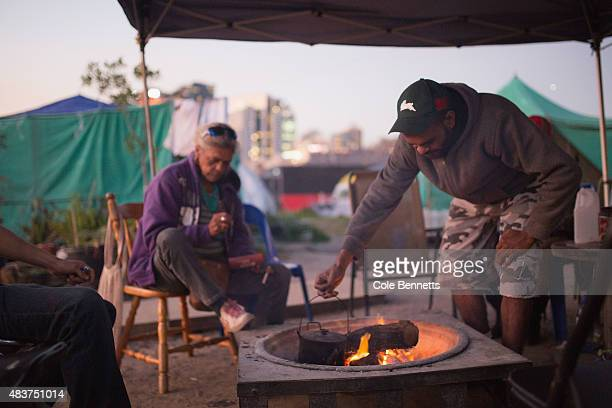 A resident of the tent embassy puts the billy on the fire on August 9 2015 in Sydney Australia The tent embassy was established in March 2014 in...