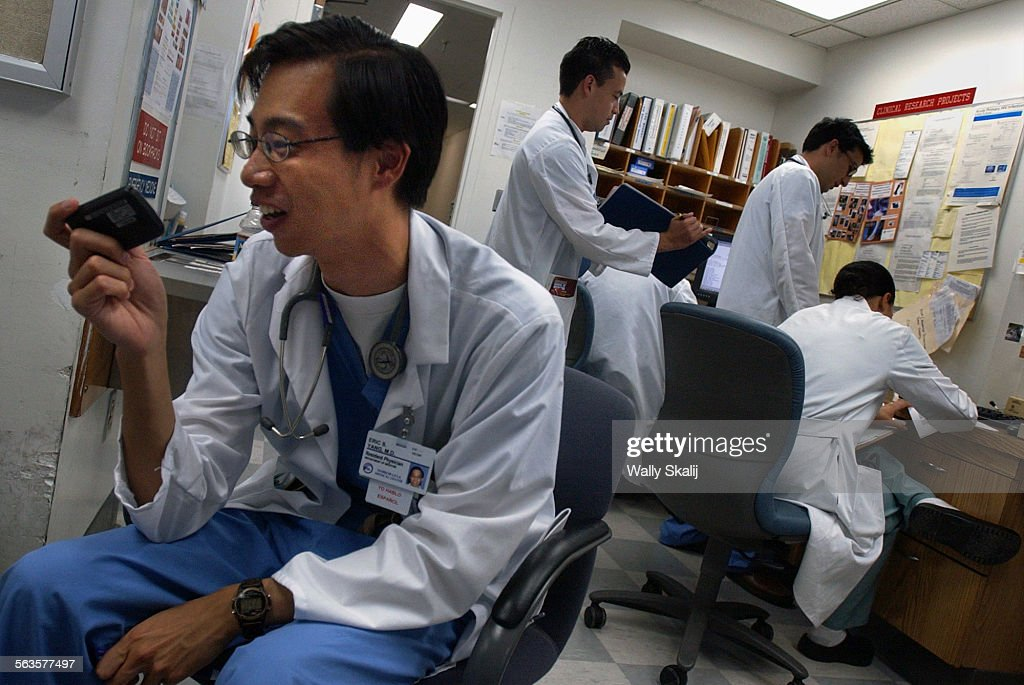 Resident physician Eric Yang checks his pager at Harbor–UCLA hospital A new rule is in effect that limit the hours residents can work