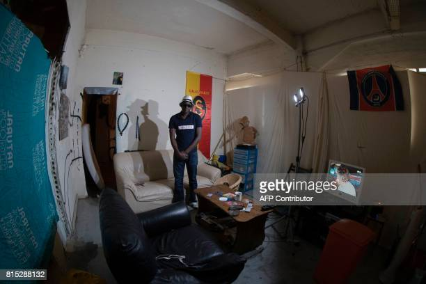 A resident poses on July 15 2017 in an apartment of the Cite de Jarry a former industrial building in Vincennes converted into an artistic squat and...