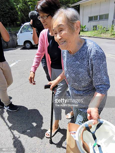A resident returns to her home as the evacuation order for Mount Sakurajima was lifted on August 22 2015 in Kagoshima Japan The volcano warning...