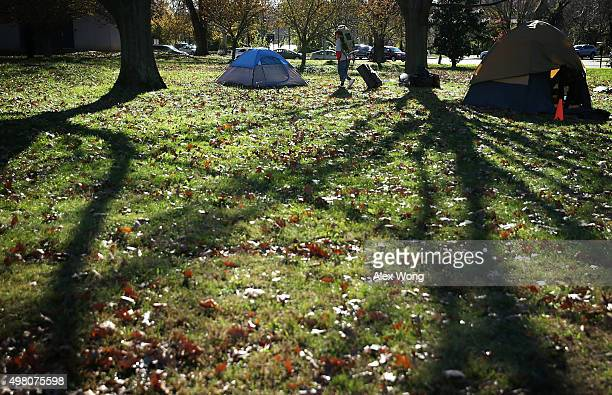 Resident Sanm Gouriny returns to his tent at a homeless encampment near K and 27th Street NW as the city tries to clear up the location November 20...