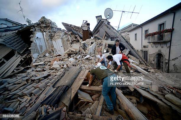 TOPSHOT Resident search for victims in the rubble after a strong earthquake hit Amatrice on August 24 2016 Central Italy was struck by a powerful...