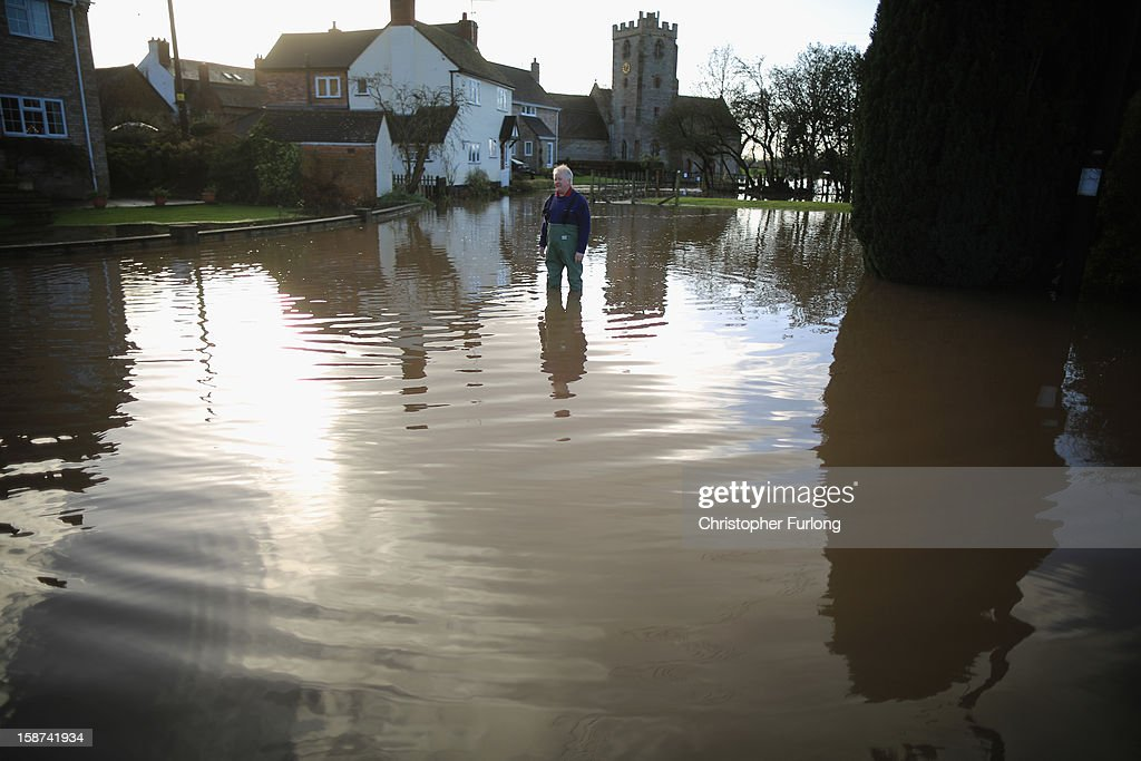 A resident surveys the flooding in the village of Severn Stoke near Worcester on December 27, 2012 in Worcester, England. 2012 could be the UK's wettest year on record according to forecasters and there are currently 88 flood warnings and 207 flood alerts in England and Wales. The Environment Agency in Hereford and Worcestershire are expecting further heavy rain, delaying a clean up until after the weekend.