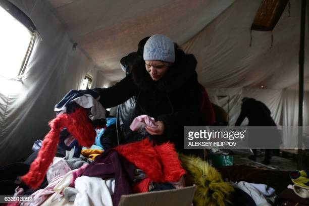 A resident takes warm clothes received as humanitarian aid in Avdiivka Donetsk region on February 5 2017 Fighting subsided around a flashpoint...